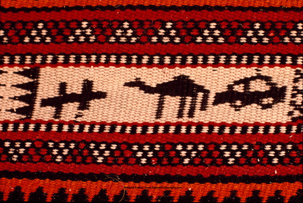 Ruwag (dividing wall) detail woven by an Al Amrah lady of a plane, camel and car. Woven and dyed goat hair. Dahana Sands, Saudi Arabia