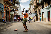 Young boy playing baseball in the street in Habana Vieja.  Photos taken by Lisa Shires in Havana, Cuba in February 2013.