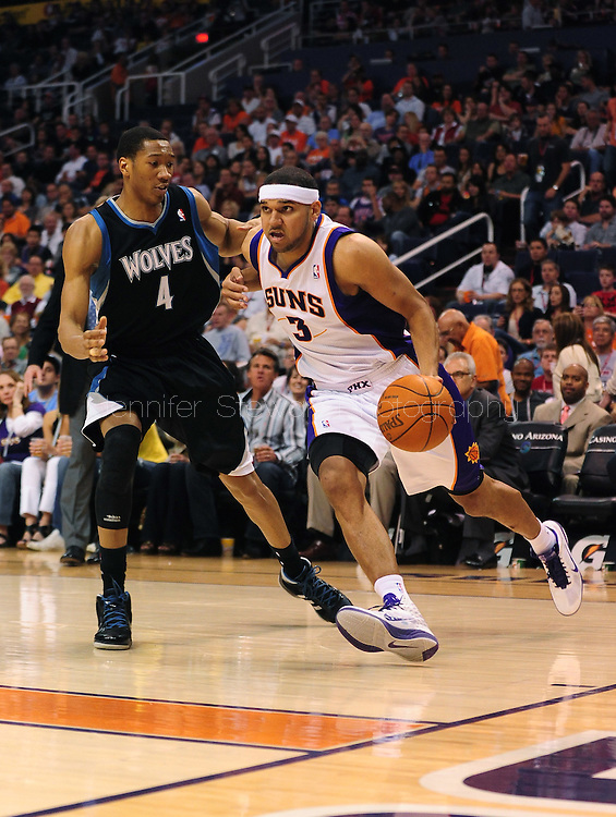 Apr. 11, 2011; Phoenix, AZ, USA; Phoenix Suns forward Jared Dudley (3) handles the ball against the Minnesota Timberwolves guard Wesley Jonson (4)at the US Airways Center. The Suns defeated the Timberwolves 135 -127 in overtime. Mandatory Credit: Jennifer Stewart-US PRESSWIRE.