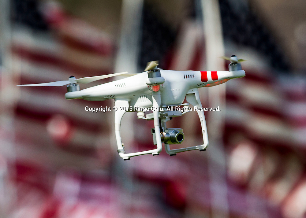 A drone is seen flying over the amongst 3,000 US flags are displayed at Pepperdine University to mark the 14th anniversary of the 9/11 terror attack, September 10, 2015 in Malibu, California.  Photo by Ringo Chiu/PHOTOFORMULA.com)