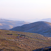 Bedouin encampments and housing development in the hills east of Jerusalem. WATERMARKS WILL NOT APPEAR ON PRINTS OR LICENSED IMAGES.