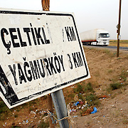 A sign points down the dirt side road leading to Celtikli, one of seven villages built by the Turkish government in Diyarbakir province for the Beritan tribe in the 1980s. The agreement to construct the villages was to the mutual benefit of the Beritan, who had previously spent the harsh winters living in tents on the outskirts of Diyarbakir, and of the government, which sought to reconcentrate the rural Kurdish population as part of its anti-PKK counterinsurgency strategy.