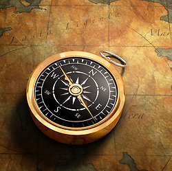 An old fashoned brass compass on a Treasure map background