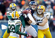 .Green Bay Packers' Nick Collins and Clay Matthews brake up a pass intended for Chicago Bears' Greg Olsen in the 2nd quarter. .The Green Bay Packers traveled to Soldier Field in Chicago to play the Chicago Bears in the NFC Championship Sunday January 23, 2011. Steve Apps-State Journal.