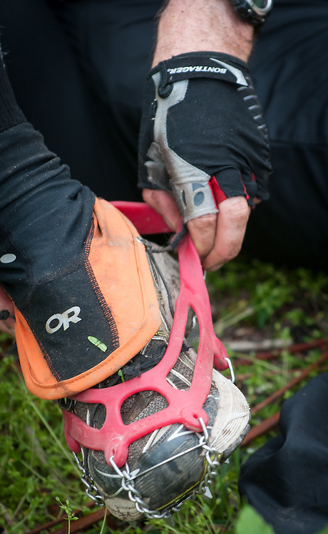 Aaron Sorenson dons micro spikes for the climb up Rat Jaw during the Barkley Marathons.