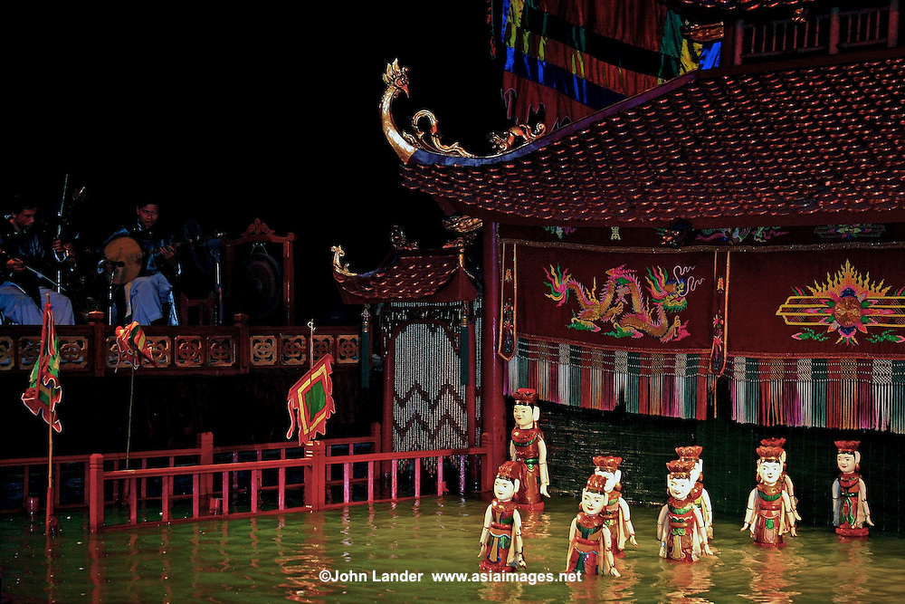 "Vietnamese water puppets at the puppet show in  Hanoi.  Though water puppet shows were originally amusement for rice farmers, using rice paddies for the ""stage"", they have become a big hit, especially in Hanoi."