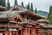 """Peaceful Byodo-In Temple is in Valley of the Temples Memorial Park, at 47-200 Kahekili Highway, Kaneohe, on the island of Oahu, Hawaii, USA. The Byodo-In Temple (""""Temple of Equality"""") was built in 1968 to commemorate the 100 year anniversary of the first Japanese immigrants to Hawaii. This Hawaii State Landmark is a non-practicing Buddhist temple which welcomes people of all faiths. One statue from a pair of """"Chinese phoenix,"""" called Hou-ou (or Hoo-oo) in Japanese, raises its wings on the rooftop of the Amida Hall (Amida-do), also known as the Phoenix Hall (Hoo-do). The legend of the Chinese phoenix, a male and female pairing called Fenghuang, arose 7000+ years ago (whereas the later Greek myth of the Western world's phoenix derived independently from ancient Egypt and Arabia). Byodo-In Temple in O'ahu is a half-scale replica of the original Byodo-in Temple built in 1053 in Uji, Japan (a UNESCO World Heritage Site)."""