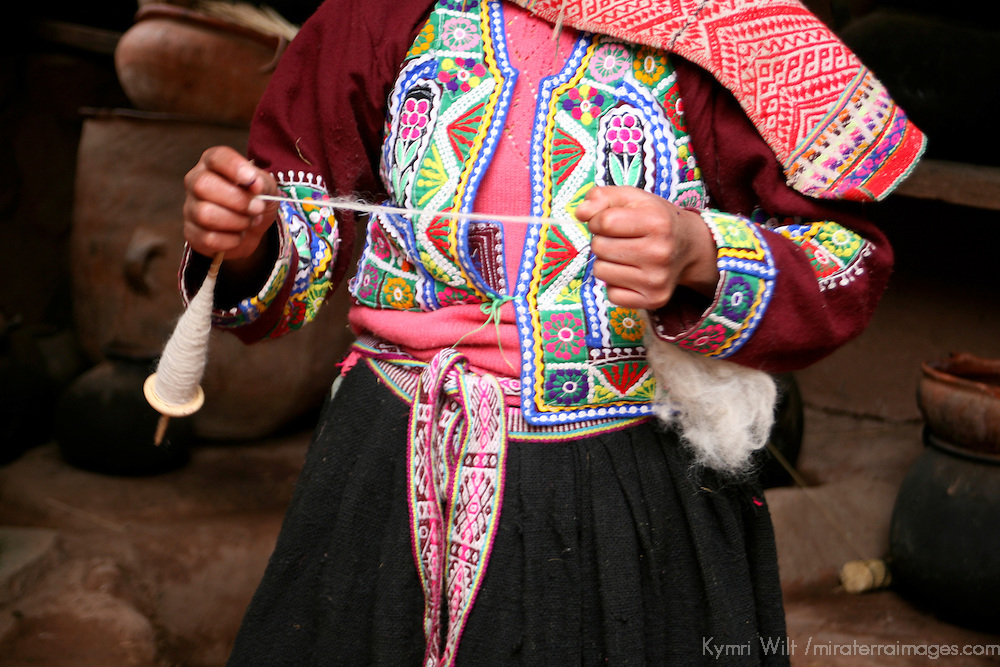 Americas, South America, Peru, Cusco.  Girl spinning wool at Awana Kancha.