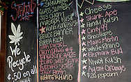 A chalkboard shows the current varietys of marijuana available for sale at a medical marijuana center in Denver April 2, 2012.  With Colorado voters set in November to decide whether to defy the federal government and legalize marijuana for recreational use under state law, the enforcement division could play a key role in bringing a black market pot trade out of the shadows.  REUTERS/Rick Wilking (UNITED STATES)