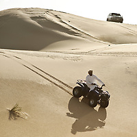 Al-Ain (Abu Dhabi), United Arab Emirates 04 April 2009.An arab drives a cuatri in the  desert of AL Ain..PHOTO: EZEQUIEL SCAGNETTI
