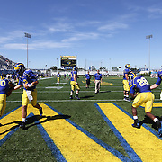 Delaware Quarterbacks Trent Hurley (12), Tim Donnelly (9), and Delaware Running Back Andrew Pierce #30 and David Hayes #28 warming up prior to a Week 3 NCAA football game against Bucknell University...#13 Delaware defeated The Bison of Bucknell 19 - 3 at Delaware Stadium Saturday Sept. 15, 2012 in Newark Delaware.