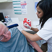 09/27/11 Hockessin DE: Walgreens Pharmacist Sue Boyd (Right) administers a flu vaccine to Al Wentz (73) Tuesday, Sept. 27, 2011 at Walgreens in Hockessin Delaware...The News Journal/SAQUAN STIMPSON