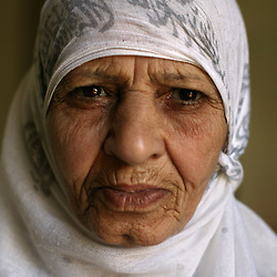 Kadija Naji, 70, is seen at a retirement home in Sadr City, Baghdad, Iraq, July 22, 2003. Even though most families in Iraq care for their aging relatives at home, there is still a need for the facility, which is the largest of its kind in Baghdad housing 45 women and 87 men. The facility was not looted during the war, but it is still lacks some funding and is in need of medications for patients with chronic conditions such as heart disease and diabetes.
