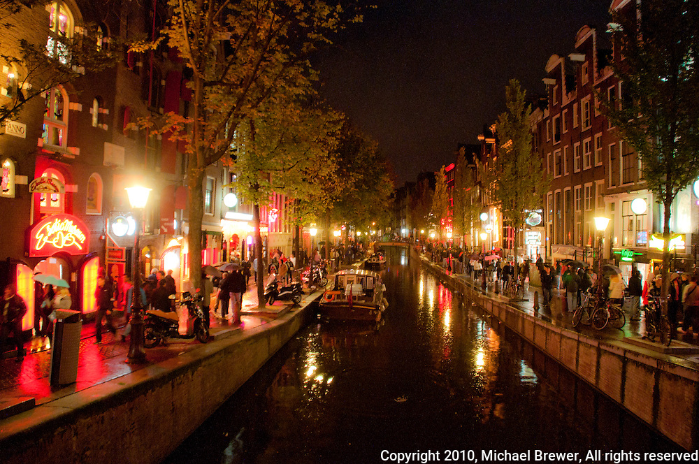 Amsterdam, Holland. The red light district at night. Lights shimmer ...