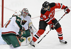 Mar 20, 2009; Newark, NJ, USA; Minnesota Wild goalie Josh Harding (29) makes a save on New Jersey Devils center Travis Zajac (19) during the third period at the Prudential Center.  The Devils defeated the Wild 4-0.