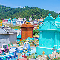 CHICHICASTENANGO , GUATEMALA - JULY 26 : Colorful Cemetery in Chichicastenango on July 26 2015. in Guatemala family members paint the tombstone as a way of honoring the dead