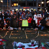 (Boston, MA - 4/26/15) Hundreds gather together at Copley Square for a vigil following the deadly earthquake in Nepal, Sunday, April 26, 2015. Staff photo by Angela Rowlings.