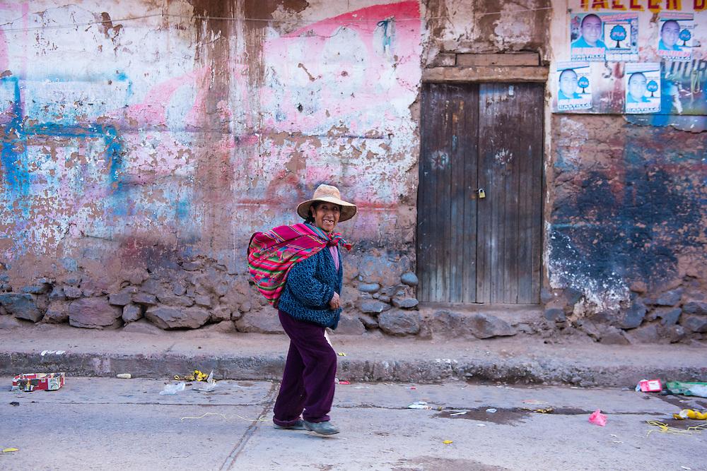 South America,Peru, woman walking in small town