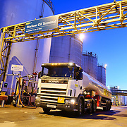 A tanker at a fuel storage facility at dusk