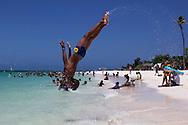 Somersaults on the beach in Guadalavaca, Holguin, Cuba.