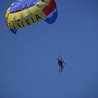 Scenes from Tunisia's resort area, El Kantouai, parasailing