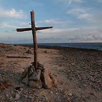 A cross on a beach where locals say smugglers often dump their drug cargo to be picked up later by fishing boats just outside of Oranjestad, Aruba on September 19, 2012. Aruba, a former Dutch colony is a popular tourist destination renowned for it's Caribbean climate and pristine beaches. It is also an infamous transit port for cocaine being smuggled out of Colombia and Venezuela in route to the U.S. and Europe. (Photo/Scott Dalton)