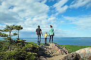 Hiking the Beehive Trail and overlooking Bar Harbor in Acadia National Park, Maine.