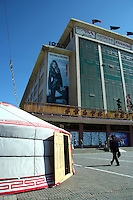 """State Department Store of Mongolia.  Still the best place to shop in Ulan Bator, despite its communist-sounding name. Flash western clothes and cosmetics are available - note the billboard. """"Ger' dwellings are also for sale here."""