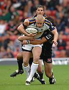 2005/06 Guinness Premiership Rugby, Saracens vs Leeds Tykes, Iain Balshaw is tackled by Sarries  Alex Sanderson, in the first half at Vicarage Road, Watford, ENGLAND: Sunday 11.09.2005.   © Peter Spurrier/Intersport Images - email images@intersport-images..   [Mandatory Credit, Peter Spurier/ Intersport Images].