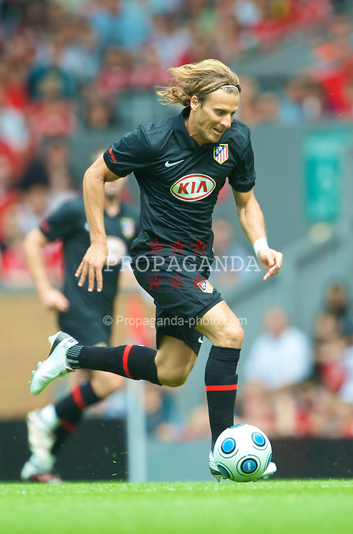 LIVERPOOL, ENGLAND - Saturday, August 8, 2009: Club Atletico de Madrid's ex-Manchester United striker Diego Forlan in action against Liverpool during the pre-season friendly match at Anfield. (Pic by: David Rawcliffe/Propaganda)