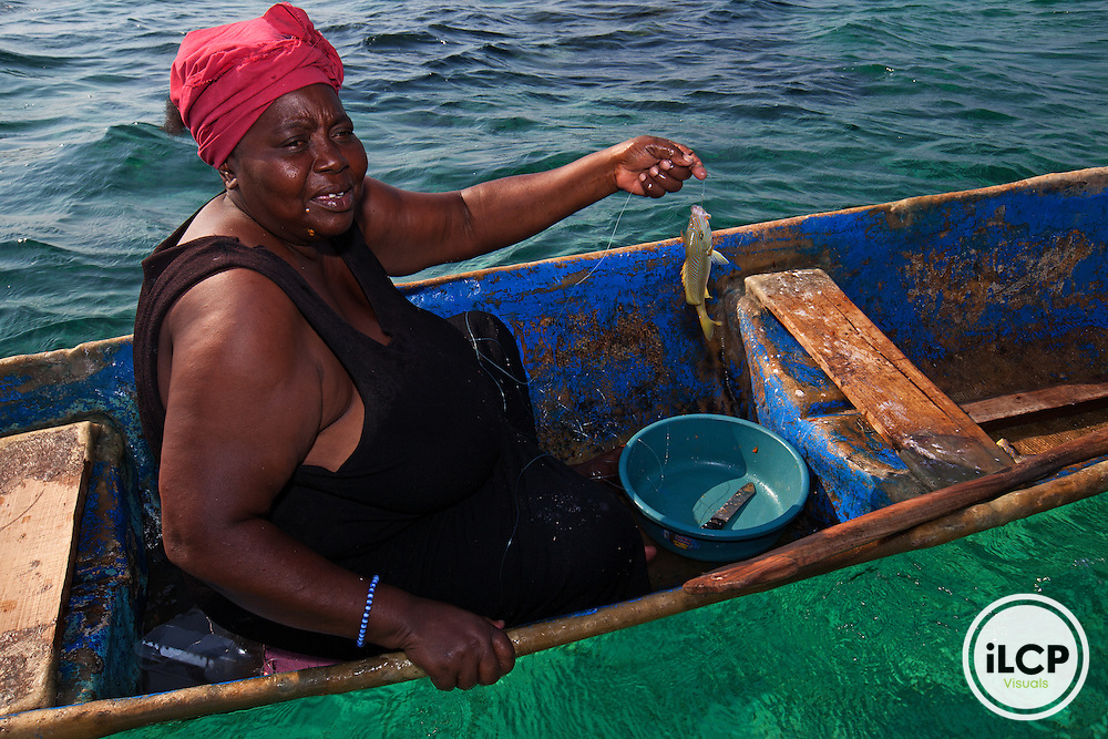 Woman fishing grunt, Garifuna community of Punta Gorda, Roatan Island, Bay Islands, Honduras, April