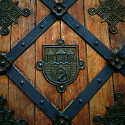 "SHOT 11/21/08 4:29:09 AM - Detail of a door in Prague. Trip to Prague, Czech Republic with Margaret. Prague is the capital and largest city of the Czech Republic. Its official name is Hlavní m?sto Praha, meaning Prague, the Capital City. Situated on the River Vltava in central Bohemia, Prague has been the political, cultural, and economic centre of the Czech state for over 1100 years. The city proper is home to more than 1.2 million people, while its metropolitan area is estimated to have a population of over 1.9 million. Since 1992, the extensive historic centre of Prague has been included in the UNESCO list of World Heritage Sites. According to Guinness World Records, Prague Castle is the largest ancient castle in the world. Nicknames for Prague have included ""the mother of cities"", ""city of a hundred spires"" and ""the golden city"". Since the fall of the Iron Curtain, Prague has become one of Europe's (and the world's) most popular tourist destinations. It is the sixth most-visited European city after London, Paris, Rome, Madrid and Berlin. Prague suffered considerably less damage during World War II than some other major cities in the region, allowing most of its historic architecture to stay true to form. It contains one of the world's most pristine and varied collections of architecture, from Art Nouveau to Baroque, Renaissance, Cubist, Gothic, Neo-Classical and ultra-modern..(Photo by Marc Piscotty / © 2008)"