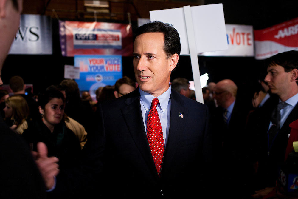 Republican presidential candidate Rick Santorum talks to the media in the spin room following the Republican presidential debate on Saturday, December 10, 2011 in Des Moines, IA.