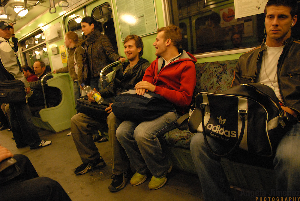 """World Champion same-sex ballroom dancers Robert Tristan Szelei, second from right, and Gergely Darabos, third from right, ride the subway in Budapest, Hungary from a practice session on October 19, 2006, as they prepare for the 2nd annual World Championship Same-Sex Ballroom Dancing competition, held in their hometown on October 21, 2006. ..Szelei and Darabos, who are known as the """"Black Swans,"""" are the reigning world champions in men?s Latin same-sex ballroom dancing. They have been training and preparing to host the 2nd annual World Championship and the Csardas Cup, the first-ever Eastern European same-sex ballroom competition, both held at the Korcsarnok arena.  This is the pinnacle event of the blossoming same-sex ballroom scene...Szelei and Darabos went on to win the men?s Standard division and finished fourth in the Latin division. ..The event was organized by the US-based World Federation of Same-Sex Dancing, which hosted the first World Championship Same-Sex championships in 2005 in Sacramento, California. The Black Swans did a large amount of the coordination and planning in Budapest, a city that had never seen an event of this kind. When government funding fell through, they secured funding from patron Desire (accent on the ?e?) Dubounet, owner of the local Club Bohemian Alibi drag club. ..The World Championship events are newly recognized, but same-sex dancers have been competing on a national and international circuit for a number of years, especially in Europe, including at the Eurogames, the Gay Games, the London Pink Jukebox Trophy and the Berlin Open, among others. Countries including the United States, the Netherlands, Germany and, now, Hungary, hold their own national same-sex championships. Hungary held its first national championships in April 2006...Szelei and Darabos spent three months at the Sacramento Dancesport same-sex dance school in California this summer, on the first scholarship offered by the World Federation. The men both got their ea"""