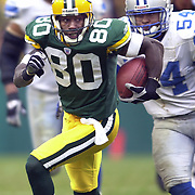Green Bay's Donald Driver runs past Detroit's Barrett Green on a 38-yard catch and run in the 2nd quarter.  Green Bay Packers hosted the Detroit Lions at Lambeau Field in Green Bay Sunday November 10, 2002. WSJ/Steve Apps. .. (PUBLISHED 11/11/02)  Donald Driver (80) had 11 catches and 130 yards Sunday, including this 38-yarder. He leads the team in receptions (46), yards (717) and TD catches (five).