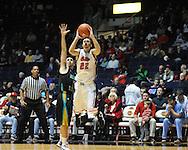 "Mississippi's Marshall Henderson (22) shoots against Coastal Carolina's Anthony Raffa (2) at the C.M. ""Tad"" Smith Coliseum in Oxford, Miss. on Tuesday, November 13, 2012. (AP Photo/Oxford Eagle, Bruce Newman)"