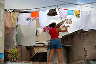 Taking down laundry in Holguin, Cuba.