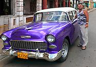 Man with his car in San Cristobal, Artemisa, Cuba.