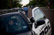 At left officer Claudia Gonzalez takes down a report after a reported domestic dispute on August 19, 2010 in Laredo, Texas. The woman filing the report had allegedly received threats from a former boyfriend. Laredo has been beefing up its police force to deal with the possibility of spillover violence, but crime remains relatively low with only six murders this year. City officials say negative attitudes about the city's more dangerous sister Nuevo Laredo have kept tourists from coming and effected the over all economics of the town.