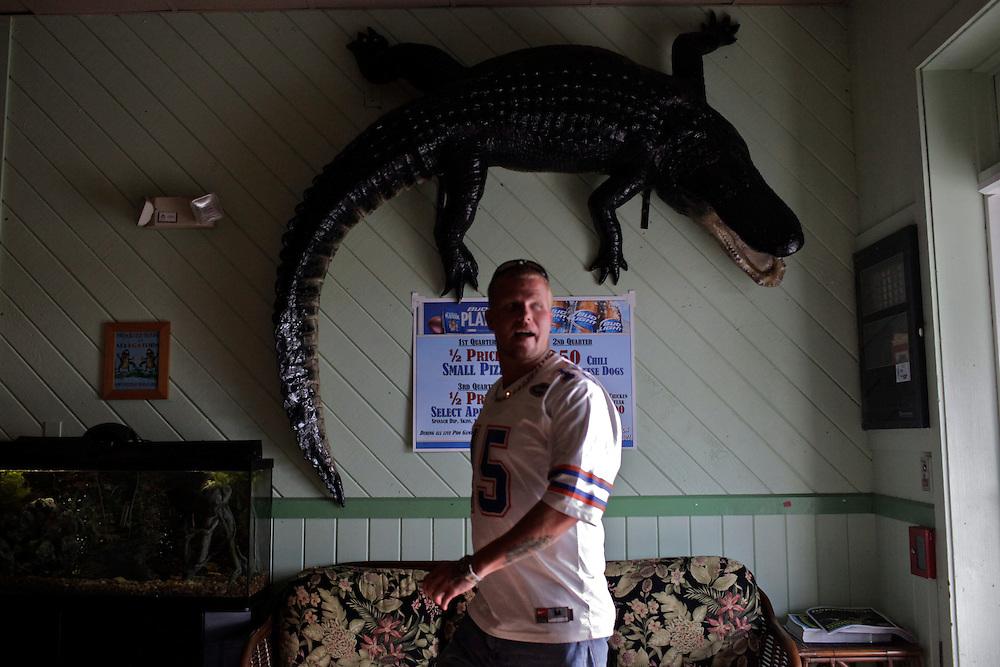 A customer wearing a University of Florida Gators jersey, walks into Alli-Gators, a theme restaurant in Fort Myers, Fla. The restaurant prides itself on gator-bites, popcorn-sized fried pieces of alligator meat. Greg Kahn/Staff