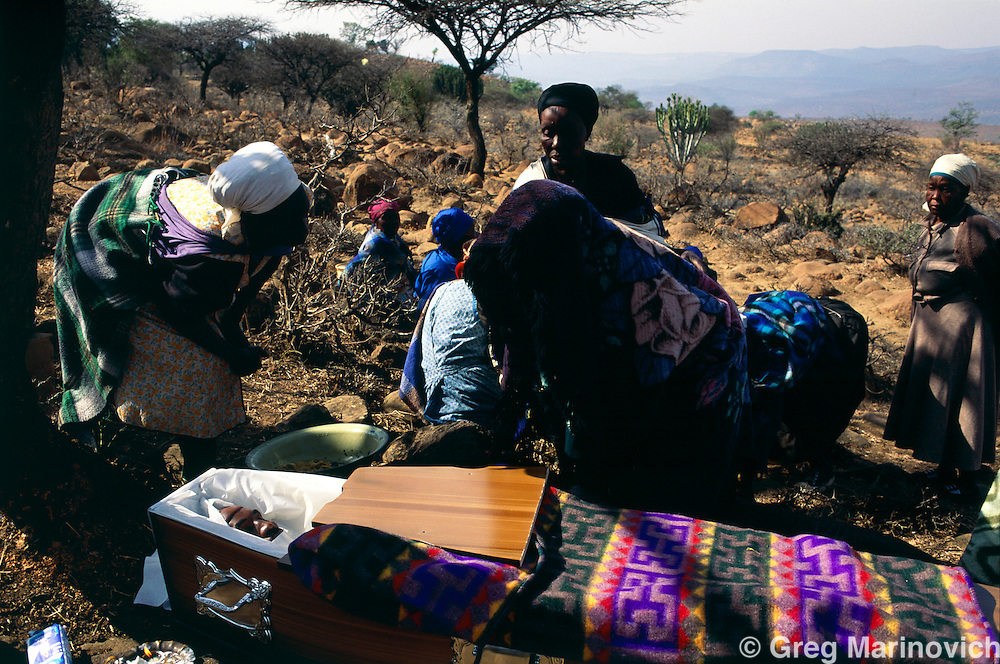 Msinga KwaZulu Natal, South Africa,   1995. The funeral of a man killed in Gauteng during a years long clan fued or faction fight in the Keate's Drift area of KwaZulu Natal, South Africa.