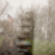 A U.S. flag is reflected in the Vietnam Veteran's Memorial in Washington, DC, on Tuesday, April 8, 2009.