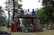 Relaxing at a dolmen in the village green park while watching the exhibitions for thanking for the hospitality at the small village of Salto, Montalegre. European Rainbow Gathering of 2011 in Portugal