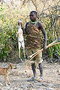 Africa, Tanzania, Lake Eyasi, Hadza hunters with bow and arrow. Hadza are a small tribe of hunter gatherers AKA Hadzabe Tribe August 2009