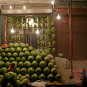 A young boy sleeps by his watermelon stand in the Iraqi area of Damascus, Syria, at about 2:30am on Thursday, July 17, 2003. Hundreds of thousands of Iraqi Shiite settled in Syria after the Gulf War and their uprising against Saddam Hussein in 1991.