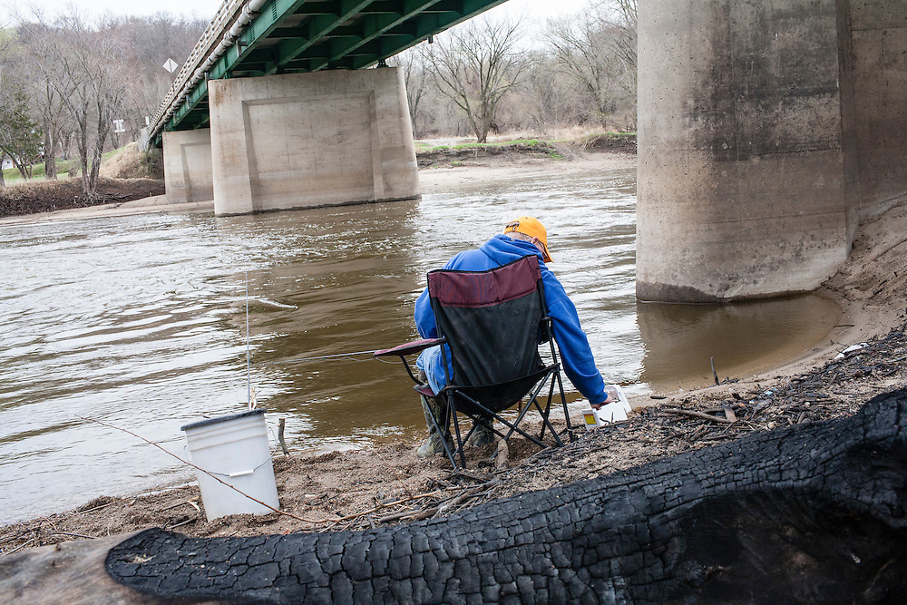 Mike Johnson fishes for walleye in the Des Moines River on Wednesday, March 21, 2012 in Webster City, IA.