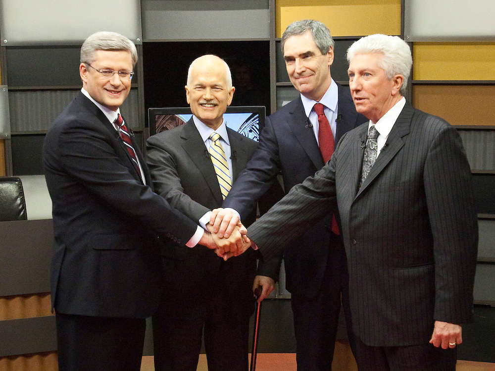 From left, Conservative leader Stephen Harper, NDP leader Jack Layton, Liberal leader Michael Ignatieff and Bloc Quebecois leader Gilles Duceppe pose for a group photo before the english language debate in Ottawa, April 12, 2011.<br /> AFP/GEOFF ROBINS/STR