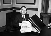 About to put an end to all the speculation: Minister for Finance Gene Fitzgerald TD puts his copy of the Examiner into his budget bag at the Department of Finance, before going to the D&aacute;il.<br />28 January 1981