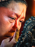 04 FEBRUARY 2017 - BANGKOK, THAILAND: Chinese opera performers put on their makeup before an opera performance for the Lunar New Year at the Phek Leng Keng Shrine in the Khlong Toey section of Bangkok. Many Chinese shrines and temples host Chinese operas during the Lunar New Year. Lunar New Year was January 28 this year and opera troupes are finishing their holiday engagements at the local temples.     PHOTO BY JACK KURTZ