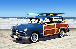 woodie car on the beach with surfboard and blue sky
